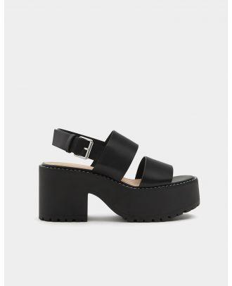 Block heel sandals with topstitching detail.