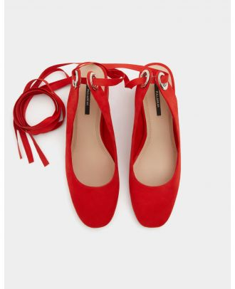 Red high heel shoes with a tied detail